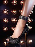 Closeup of a woman leg wearing a luxury high heel shoe on a dance floor
