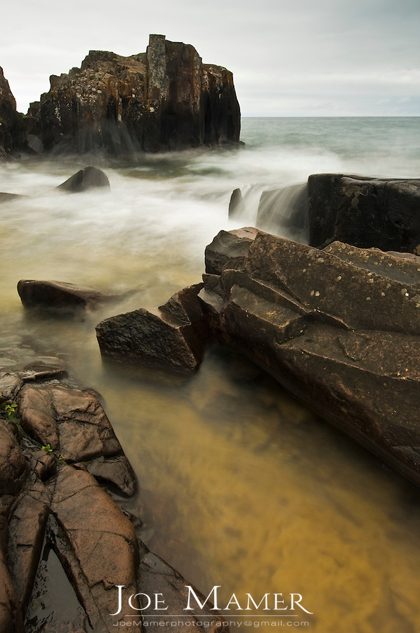 Waves rush through rocks along the North Shore of Lake Superior at Artists Point.