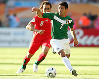Zinha of Mexico plays the ball in front of Ali Karimi of Iran. Mexico defeated Iran 3-1 during a World Cup Group D match at Franken-Stadion, Nuremberg, Germany on Sunday June 11, 2006.  Zinha scored Mexico's third goal.