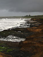 Stormy sky, frothy waves and rugged rocky shoreline - the beach north of Pigeon Point State Historic Park, California