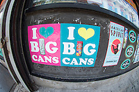"Advertisements for Arizona beverages seen outside a grocery store in the Lower East Side in New York on Saturday, May 26, 2012.  Some people complain the advertising campaign ""I Love Big Cans"" is demeaning to women.  (© Frances M. Roberts)"