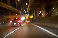Night time commuters travel through the downtown I-35 corridor, an underground maze of highways and interchanges in downtown Austin, Texas.