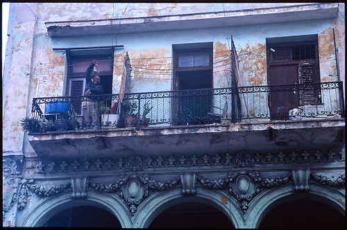 Old man on balcony, Havana, Cuba by Paul Cooklin