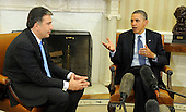 United States President Barack Obama and President Mikheil Saakashvili of Georgia meet reporters after a bilateral meeting in the Oval Office of the White House, January 30, 2012, Washington, DC. The two leaders discussed Georgia's contributions to security in Afghanistan as well as mutual cooperation in trade, tourism, energy, science and culture.  .Credit: Mike Theiler / Pool via CNP