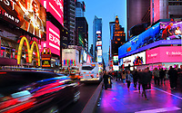 Billboards and evening crowds on Broadway, New York, New York, USA. Broadway is the Theater District of Manhattan, with 41 professional theatres. Broadway is the oldest North-South street in New York City, and is 13 miles long. Picture by Manuel Cohen