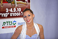 """Caroline Weber of Austria smiles to camera at """"kiss & cry"""" during event finals at 2010 Holon Grand Prix at Holon, Israel on September 4, 2010.  (Photo by Tom Theobald)."""