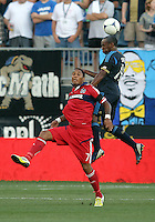 CHESTER, PA - AUGUST 12, 2012:  Amobi Okugo (14) of the Philadelphia Union heads away from  Sherjill McDonald (7) of the Chicago Fire during an MLS match at PPL Park, in Chester, PA on August 12. Fire won 3-1.