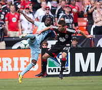 Peterson Joseph (19) of Sporting Kansas City fights for the ball with Perry Kitchen (23) of D.C. United during a Major League Soccer match at RFK Stadium in Washington, DC.  D.C. United tied Sporting Kansas City, 1-1.