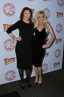 HOLLYWOOD, CA - OCTOBER 18: Cassandra Peterson, Bridget Marquardt attends the launch party for Cassandra Peterson's new book 'Elvira, Mistress Of The Dark' at the Hollywood Roosevelt Hotel on October 18, 2016 in Hollywood, California. (Credit: Parisa Afsahi/MediaPunch).