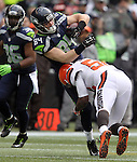 Seattle Seahawks tight end Cooper Helfet (84) is tackled by Cleveland Browns linebacker Karlos Danby (56) at CenturyLink Field in Seattle, Washington on December 20, 2015. The Seahawks clinched their fourth straight playoff berth in four seasons by beating the Browns 30-13.  ©2015. Jim Bryant Photo. All Rights Reserved.