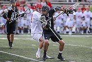 College Park, MD - May 14, 2017: Bryant Bulldogs Tucker James (1) holds off the Maryland Terrapins defender during the NCAA first round game between Bryant and Maryland at  Capital One Field at Maryland Stadium in College Park, MD.  (Photo by Elliott Brown/Media Images International)