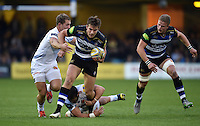 Max Clark of Bath Rugby takes on the Exeter Chiefs defence. West Country Challenge Cup match, between Bath Rugby and Exeter Chiefs on October 10, 2015 at the Recreation Ground in Bath, England. Photo by: Patrick Khachfe / Onside Images