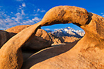 Dawn light on Lone Pine Peak through Mobius Arch, Alabama Hills, Inyo National Forest, California USA