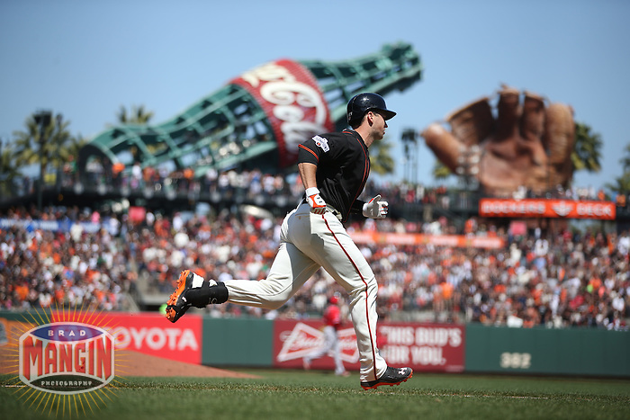SAN FRANCISCO, CA - MAY 2:  Buster Posey #28 of the San Francisco Giants runs to first base against the Los Angeles Angels during the game at AT&T Park on Saturday, May 2, 2015 in San Francisco, California. Photo by Brad Mangin