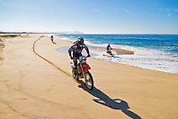 Group of motorcycle riders on empty beach, Mexico