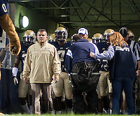 Pitt head coach Todd Graham (yellow jacket). The Pitt Panthers defeated the USF Bulls 44-17 on September 29, 2011 at Heinz Field in Pittsburgh Pennsylvania.