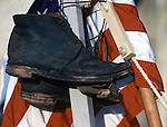 A worn pair of U.S. Army 's Jefferson Brogans, the first shoes issued in during the Civil War, hangs on tent posts during the Battle of Fort Morgan, Mobile, Al in 2001. Jim Bryant Photo. @2001. All Rights Reserved.