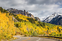 Road to Rico. Highway 145 and view of  snow covered Yellow Mountain with the Ophir Needles and Autumn Aspens in the Foreground. This is part of the San Juan Skyway, a scenic byway that snakes through the whole San Juan Mountain Range.