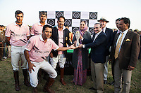 Her Highness Rajmata Padmini Devi (center) and Jewelry designer Nirav Modi (4th from right) present the winner's trophy to the Royal Jaipur Polo Team after they beat the Western Australian Polo Team by a slight margin at thelast minutes of the Argyle Pink Diamond Cup, organised as part of the 2013 Oz Fest in the Rajasthan Polo Club grounds in Jaipur, Rajasthan, India on 10th January 2013. Photo by Suzanne Lee