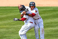 GRAND CHUTE - July 2014: Rafael Neda (12) and Jose Pena (37) of the Wisconsin Timber Rattlers celebrate a walk-off win in a game against the Dayton Dragons on July 21st, 2014 at Fox Cities Stadium in Grand Chute, Wisconsin.  (Photo Credit: Brad Krause)