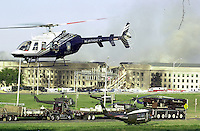 September 11, 2001_ The Pentagon, Washington, DC.Rescue efforts continue into the afternoon at the Pentagon building with various agency and police resorces coming to the scene..(C) 2001 Sandy Schaeffer / MAI / TimePix Sandy Schaeffer Photography - Washington DC Photographer<br />