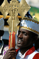 Eritrea. Asmara. September square. Meskel is the most important religious feast for the orthodox church in Eritrea. It takes place every year on september 27.  The man wears a holy cross on his forehead and holds in his hands a stick with a golden cross and Jesus.  He sings, and will later pray.  © 2002 Didier Ruef