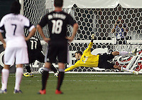 Luciano Emilio #11 of D.C. United beats Kyle Reynish #24  of Real Salt Lake  to score from the penalty spot during an Open Cup match at RFK Stadium, on June 2 2010 in Washington DC. DC United won 2-1.