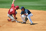 Alabama's Jon Kelton (10) doubles as Ole Miss' Blake Newalu (6) applies the tag at Oxford-University Stadium in Oxford, Miss. on Sunday, March 20, 2011.