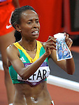 Ethiopia's Meseret Defar wins the Women's 5000m at the London Olympics on Friday, August 10, 2012, in London, England. (AP Photo/Margaret Bowles)