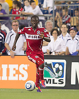 Chicago Fire midfielder Patrick Nyarko (14) dribbles at midfield. In a Major League Soccer (MLS) match, the New England Revolution tied the Chicago Fire, 1-1, at Gillette Stadium on June 18, 2011.