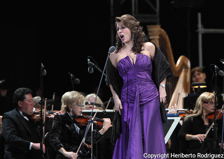 Opera soprano singer Eugenia Garza performs an opera song during the Concert of the Angel in Mexico City, December 19, 2009. Garza debuted in 1998 season with the Plm Beach Opera as Mimi in La Boheme and participated in numerous operas in Mexico and the United States performing different roles in operas by Bizet, Donizetti, Leoncavallo, Offenbach, among others. Photo by Heriberto Rodriguez