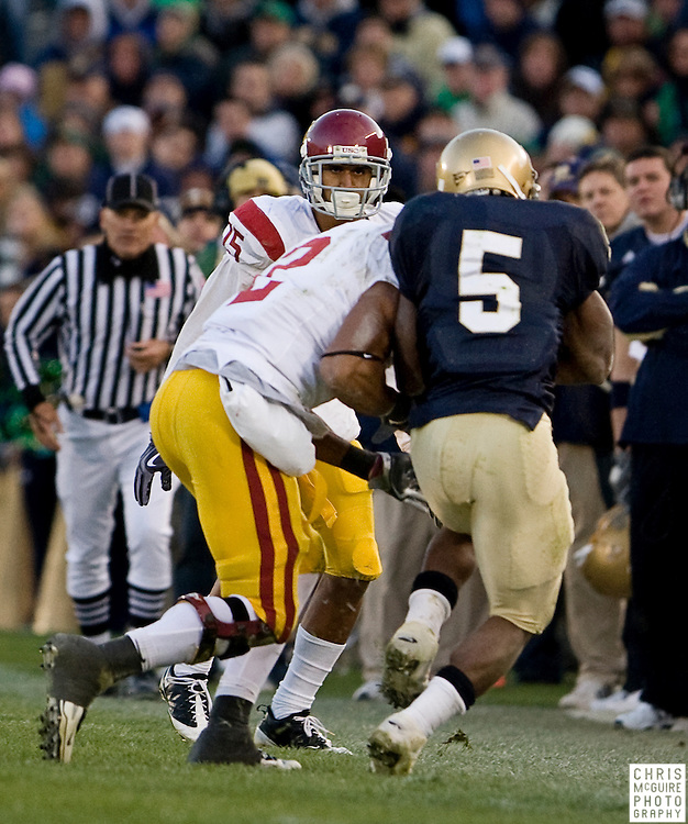 10/17/09 - South Bend, IN:  USC safety Taylor Mays lays a hit on Notre Dame running back Armando Allen Jr during the fourth quarter of their game at Notre Dame Stadium on Saturday.  Mays was flagged for a late hit on the play.  USC went on to win the game 34-27 to extend its win streak over Notre Dame to 8 games.  Photo by Christopher McGuire.
