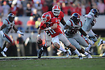 Georgia quarterback Aaron Murray (11) is chased by Ole Miss defensive tackle Bryon Bennett (95) at Sanford Stadium in Athens, Ga. on Saturday, November 3, 2012.