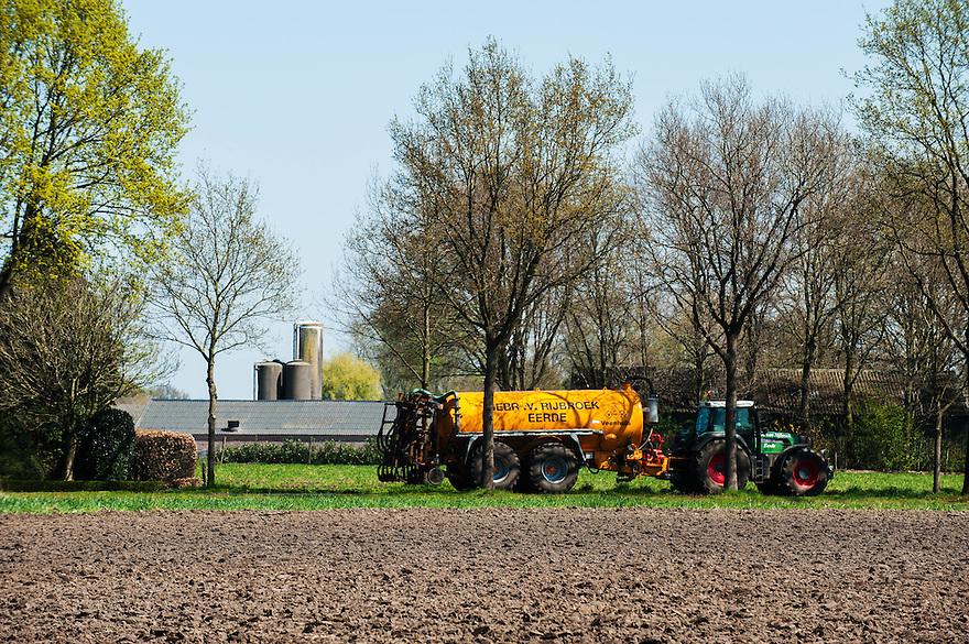 Nederland, omgev. Boekel, 20 april 2015<br /> Grote stallen en voedersilo's.<br /> <br /> Foto: Michiel Wijnbergh