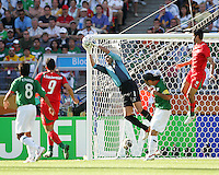 Mexican goalkeeper Oswaldo Sanchez pulls in a corner kick attempt. Mexico defeated Iran 3-1 during a World Cup Group D match at Franken-Stadion, Nuremberg, Germany on Sunday June 11, 2006.