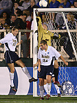 1 December 2006: Notre Dame's Lauren Karas (in yellow) makes a save by punching the ball clear over teammates Christie Shaner (18) and Jill Krivacek (24). The University of Notre Dame Fighting Irish defeated Florida State Seminoles 2-1 at SAS Stadium in Cary, North Carolina in an NCAA Division I Women's College Cup semifinal game.