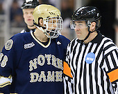 T.J. Tynan (Notre Dame - 18), Marco Hunt - The University of Notre Dame Fighting Irish defeated the Merrimack College Warriors 4-3 in overtime in their NCAA Northeast Regional Semi-Final on Saturday, March 26, 2011, at Verizon Wireless Arena in Manchester, New Hampshire.