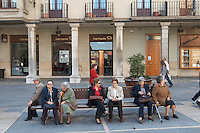 old people on a bench Plaza de Regla , Leon spain castile and leon