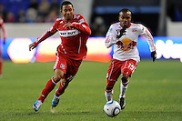 Mike Banner (18) of the Chicago Fire and Dane Richards (19) of the New York Red Bulls chase down a ball during the first half of a Major League Soccer match between the New York Red Bulls and the Chicago Fire at Red Bull Arena in Harrison, NJ, on March 27, 2010. The Red Bulls defeated the Fire 1-0.