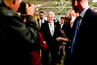 Republican presidential candidate Newt Gingrich leaves after a campaign meeting with employees of Global Security Services on Monday, December 19, 2011 in Davenport, IA.