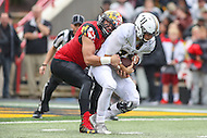 College Park, MD - October 1, 2016: Maryland Terrapins defensive lineman Roman Braglio (90) sacks Purdue Boilermakers quarterback David Blough (11) during game between Purdue and Maryland at  Capital One Field at Maryland Stadium in College Park, MD.  (Photo by Elliott Brown/Media Images International)