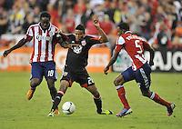 D.C. United forward Lionard Pajoy (26) goes against Chivas USA midfielder Sharlie Joseph (18)  D.C. United defeated Chivas USA 1-0 at RFK Stadium, Sunday September 23, 2012.