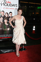 "Debra Messing  arriving at the Premiere of ""Nothing Like the Holidays"" at the Grauman's Chinese Theater in Hollywood, CA.December 3, 2008.©2008 Kathy Hutchins / Hutchins Photo....                ."