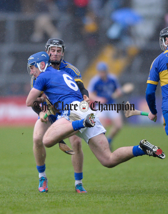 Colin Ryan of Newmarket On Fergus in action against Conor Ryan of Cratloe during the senior county hurling final at Cusack Park. Photograph by John Kelly.
