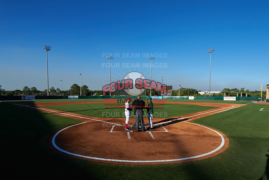 Florida Fire Frogs manager Paul Runge (left) during the lineup exchange with manager Eli Marrero (right) and umpire Jose Navas (center) before the teams inaugural game against the Daytona Tortugas on April 6, 2017 at Osceola County Stadium in Kissimmee, Florida.  Daytona defeated Florida 3-1.  (Mike Janes/Four Seam Images)