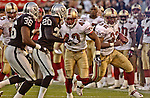 San Francisco 49ers running back Kevan Barlow (32) on Sunday, November 3, 2002, in Oakland, California. The 49ers defeated the Raiders 23-20 in an overtime game.