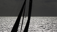 FRANCE,  Point Penmarc'h. 1st July 2012. Volvo Ocean Race, Leg 9 Lorient-Galway. PUMA Ocean Racing powered by BERG, with Team Telefonica in the distance.