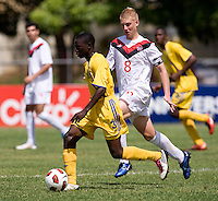 Bryce Alderson (8) of Canda tries to catch up to Romario Griffith (3) of Barbados during the group stage of the CONCACAF Men's Under 17 Championship at Jarrett Park in Montego Bay, Jamaica. Costa Rica defeated El Salvador, 3-2.