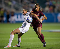 Kassey Kallman (9) of Florida State fights for the ball with Jazmine Reeves (5) of Virginia Tech during the Women's College Cup semifinals at WakeMed Soccer Park in Cary, NC. Florida State defeated Virginia Tech, 3-2.