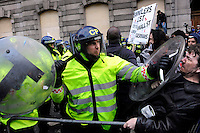 A policeman pushes back demonstrators outside the Bank of England as thousands of protestors descended on the City of London ahead of the G20 summit of world leaders to express anger at the economic crisis, which many blame on the excesses of capitalism.